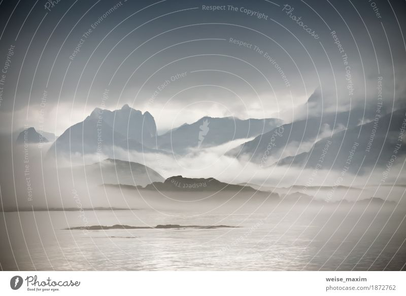 Coast of Norway sea in clouds of fog. Cloudy Nordic Nature Vacation & Travel Summer Water Ocean Landscape Clouds Far-off places Beach Mountain Lifestyle Natural Coast Freedom Stone Rock