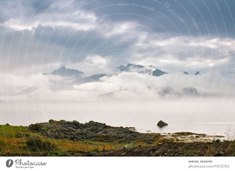 Coast of Norway sea in clouds of fog. Cloudy Nordic day Sky Nature Vacation & Travel Summer Ocean Landscape Clouds Far-off places Beach Mountain Lifestyle Natural Freedom Stone Tourism Rain