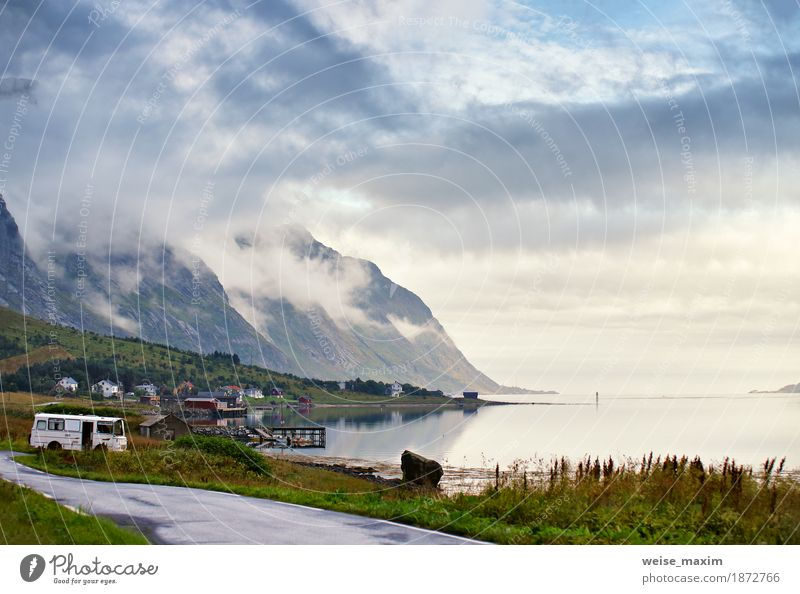 Norway villages in fjord on lofoten islands. Cloudy Nordic day Sky Nature Vacation & Travel Blue Summer Ocean Landscape Clouds House (Residential Structure)