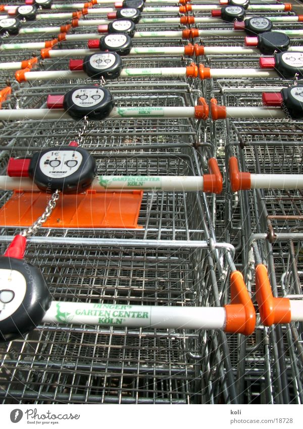 Orange Metal Multiple Store premises Services Row Many Shopping Trolley