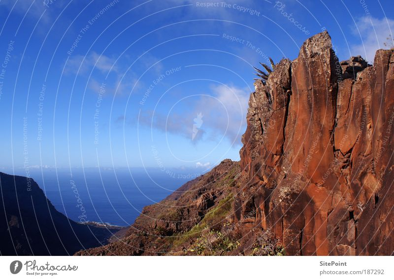 Like in the Wild West Landscape Sky Clouds Rock Mountain Ocean Island Stone Water Horizon Gomera Red Blue Far-off places Colour photo Exterior shot Twilight