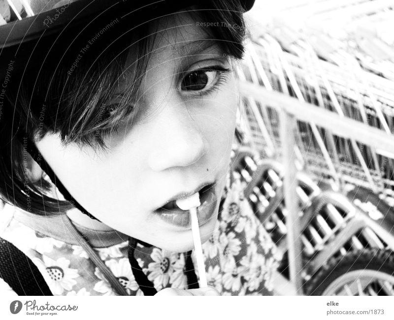 lollipop or what's left Girl Child Bike helmet Lollipop Nutrition Black & white photo