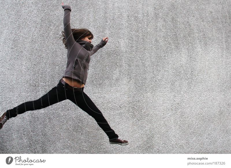 Woman Youth (Young adults) Human being Joy Life Wall (building) Jump Movement Freedom Gray Legs Contentment Healthy Body