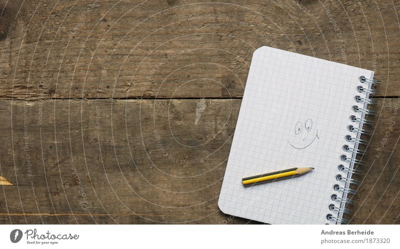 a smile Contentment Desk Office Business Musical notes Print media Paper Piece of paper Pen Smiling Happiness book table spiral Background picture white notepad