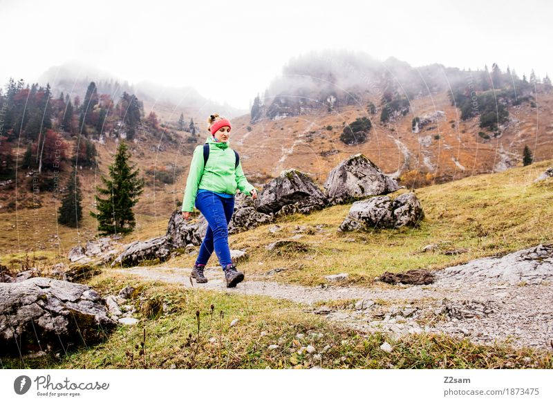 Proud step Leisure and hobbies Mountain Hiking Sports Young woman Youth (Young adults) 18 - 30 years Adults Clouds Autumn Bad weather Fog Alps Going