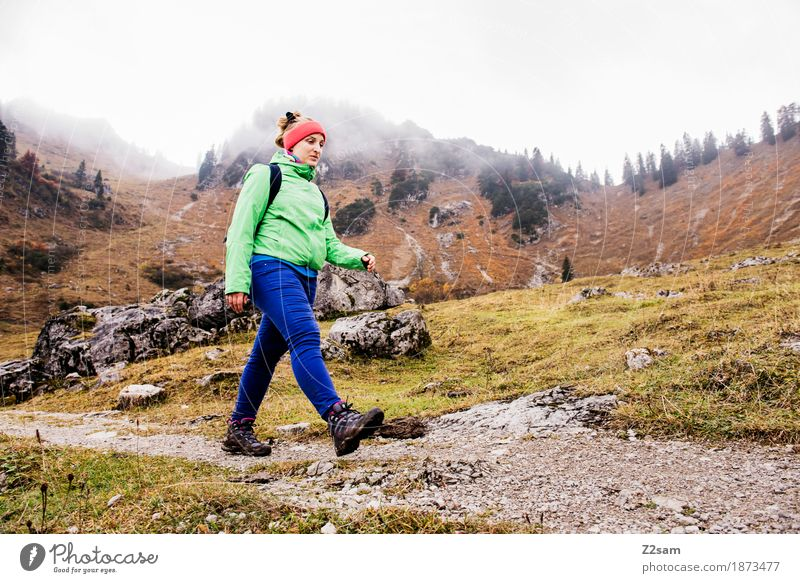 Proud step Leisure and hobbies Mountain Hiking Sports Young woman Youth (Young adults) 18 - 30 years Adults Nature Landscape Clouds Autumn Bad weather Fog Alps