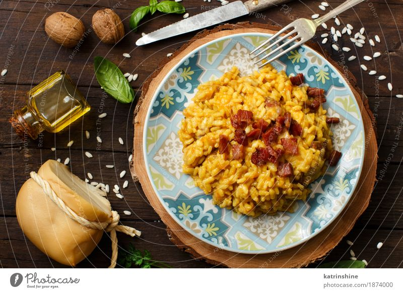 Risotto with a pumpkin and bacon Cheese Vegetable Grain Herbs and spices Lunch Dinner Diet Italian Food Plate Bowl Bottle Fork Wood Bright Delicious Blue Yellow