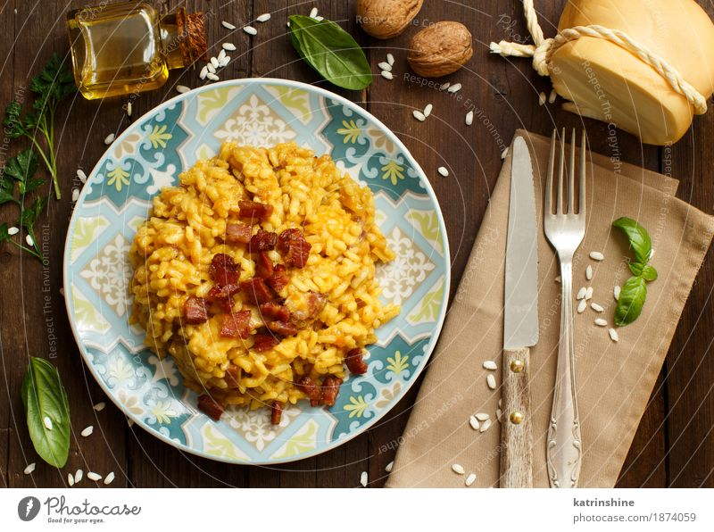 Risotto with a pumpkin and bacon Cheese Vegetable Grain Herbs and spices Cooking oil Nutrition Lunch Dinner Diet Italian Food Plate Bowl Bottle Fork Wood Bright