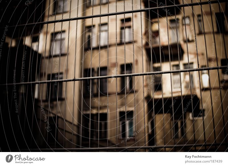 Behind bars Flat (apartment) Redecorate Europe Town Deserted High-rise Building Architecture Facade Balcony Window Fence Old Dirty Dark Brown Safety Protection