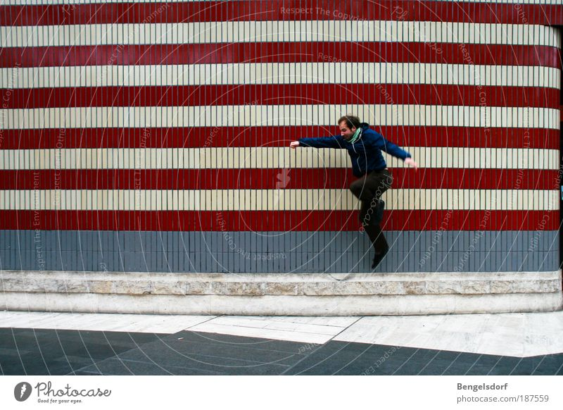 Human being Man Blue White Red Adults Life Wall (building) Playing Architecture Jump Wall (barrier) Building Facade Leisure and hobbies Wait