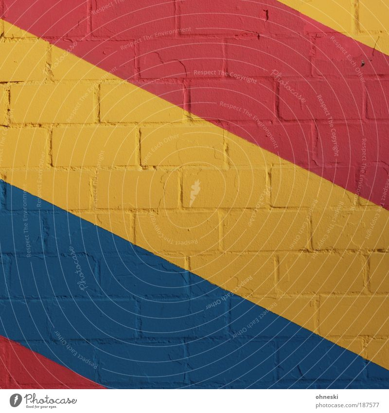 streaked House (Residential Structure) Manmade structures Building Architecture Wall (barrier) Wall (building) Facade Stone Blue Multicoloured Yellow Red Colour