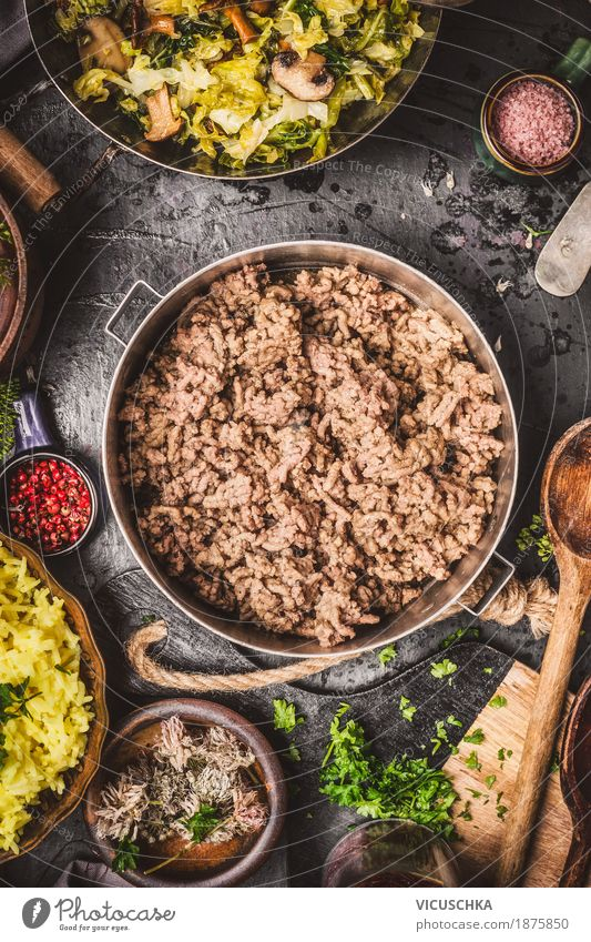 minced meat in a saucepan on a rustic kitchen table Food Meat Vegetable Herbs and spices Cooking oil Nutrition Dinner Banquet Organic produce Crockery Plate