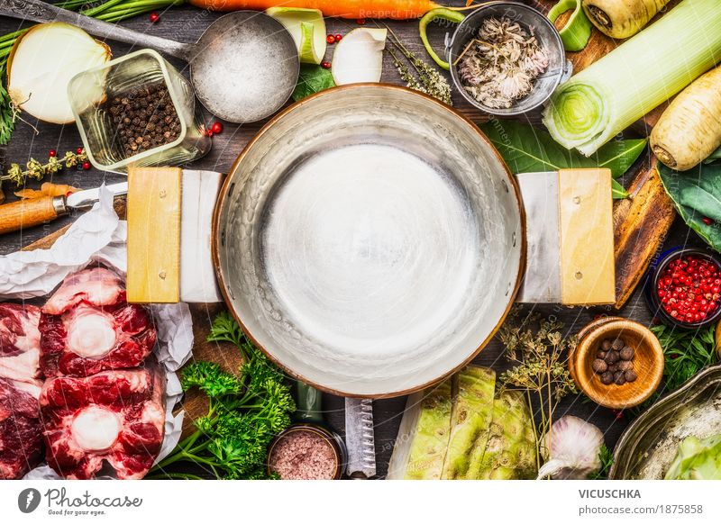 Ingredients for soup or broth around cooking pot Food Meat Vegetable Soup Stew Herbs and spices Nutrition Organic produce Crockery Pot Knives Spoon Style Design