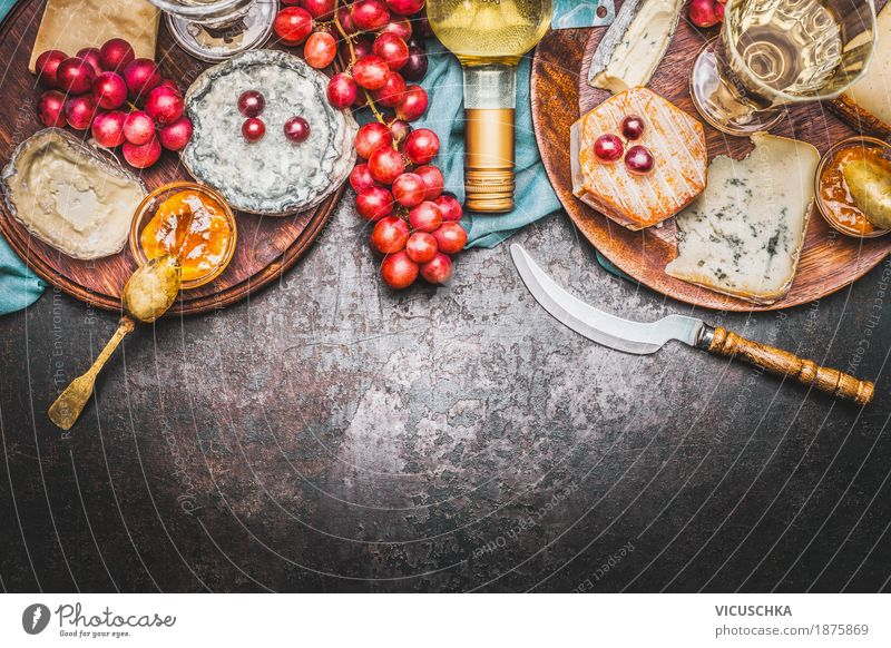 Cheese selection with bottle of wine, honey mustard sauce and grapes Food Fruit Nutrition Banquet Organic produce Beverage Wine Crockery Bowl Knives Style