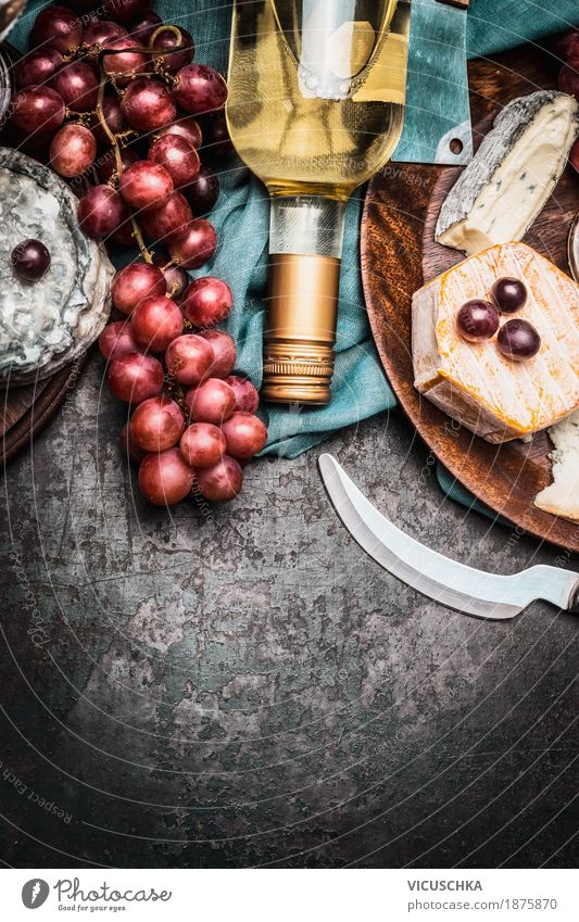Cheese with wine and grapes Food Dairy Products Fruit Nutrition Banquet Beverage Wine Knives Style Design Table Party Event Restaurant Yellow Brie bottle Snack
