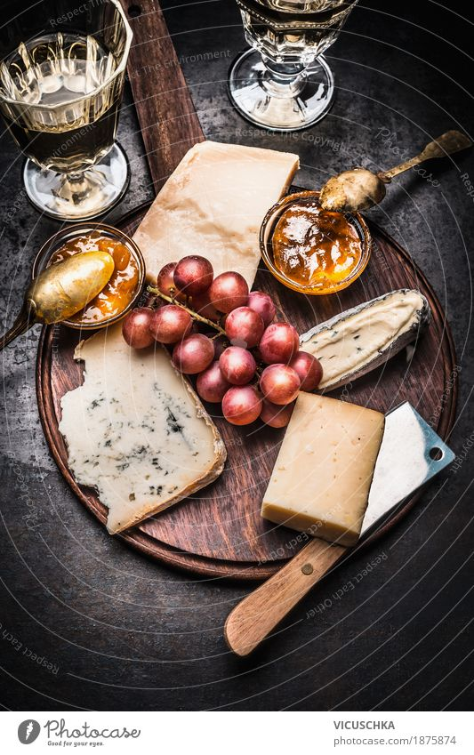 Fine cheese selection with wine, honey mustard sauce and grapes Food Cheese Fruit Nutrition Buffet Brunch Banquet Beverage Wine Crockery Glass Knives Style