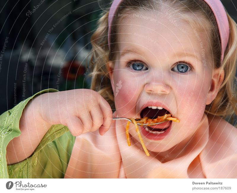 Human being Child Girl Green Noodles Nutrition Portrait photograph Exterior shot Blonde Eating Food Colour Natural Infancy Delicious Toddler