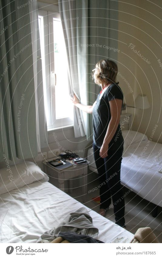 When are you coming? Feminine Woman Adults 30 - 45 years Window Looking Stand Wait Gray White Anticipation Curiosity Hope Boredom Longing Living or residing Bed
