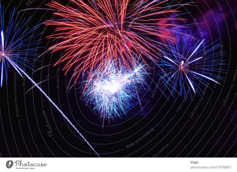 Blue and red colorful fireworks on the black sky Sky Blue Christmas & Advent Colour White Red Joy Dark Black Yellow Art Feasts & Celebrations Party Orange Bright New