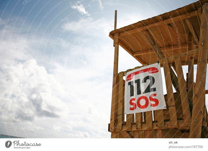 SOS Vacation & Travel Beach Air Wood Digits and numbers Signage Warning sign Threat Help Hope Emergency call Pool attendant Colour photo Exterior shot Deserted