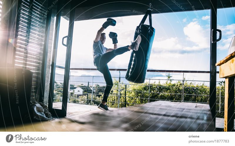 Young adult man doing boxing workout on balcony at home Human being Youth (Young adults) Lifestyle Leisure and hobbies Masculine Power Action Energy Fitness Balcony Home Muscular Hard Practice Boxing Sportswear