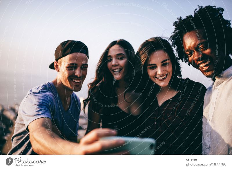 Multi ethnic group of young adult friends taking selfie Woman Man Relaxation Joy Adults Lifestyle Laughter Group Friendship Technology Authentic Happiness Smiling Photography Cool (slang) Telephone