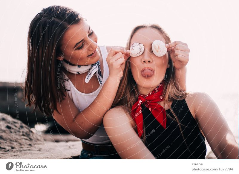Teenager Girls pulling faces and playing with shell at the beach Vacation & Travel Youth (Young adults) Young woman Joy Girl Beach Lifestyle Laughter Tourism Together Friendship Bright 13 - 18 years Happiness Smiling Summer vacation