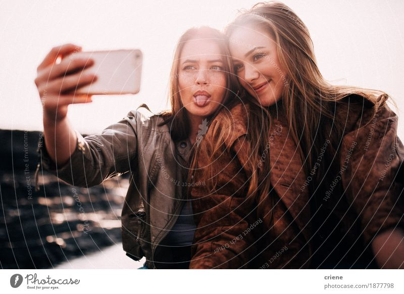 Teenager Best friends taking selfie with smart phone Vacation & Travel Youth (Young adults) Young woman Joy Lifestyle Laughter Together Friendship Technology Happiness Smiling Photography Telephone Camera Relationship Digital