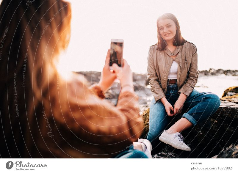 Girl taking photo of her friend with smartphone Vacation & Travel Youth (Young adults) Young woman Joy Beach Lifestyle Laughter Rock Together Friendship 13 - 18 years Technology Happiness Smiling Photography Telephone