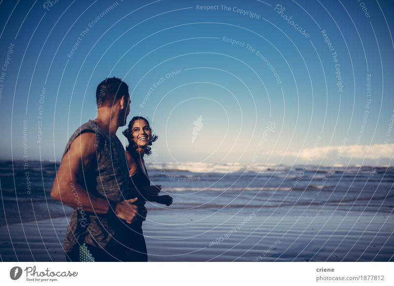 Fit couple doing running workout together on the beach Lifestyle Body Wellness Relaxation Beach Ocean Jogging Young woman Youth (Young adults) Young man Couple