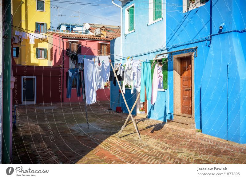 Hung laundry on the lines in front of houses in Burano. Sky Vacation & Travel Blue Summer Colour Green Ocean Red House (Residential Structure) Clouds