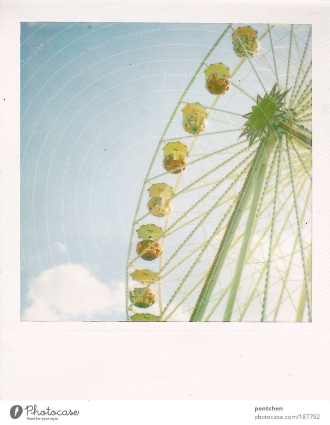 Polaroid shows a big wheel in front of a blue sky. carnival, funfair, dult Lifestyle Joy Leisure and hobbies Trip Oktoberfest Fairs & Carnivals Event Movement