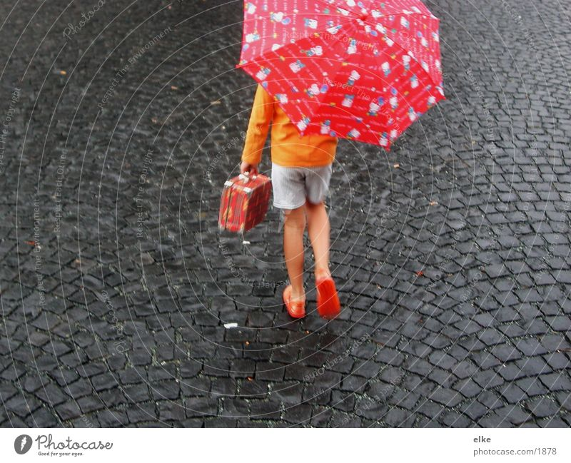 off to the south Child Going Umbrella Asphalt Human being Movement Rain Stone