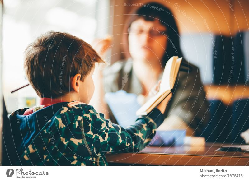 Mother and son in the railway Vacation & Travel Train travel Railroad Human being Child Adults Family & Relations Infancy 2 3 - 8 years Reading Colour photo