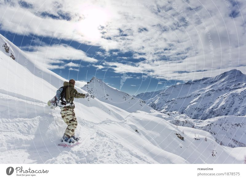 Snowboarder goes downhill over a snowy mountain landscape Vacation & Travel Winter Mountain Sports Skiing Boy (child) Landscape Sky Alps Freeze Speed Clear sky