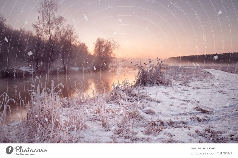 Winter misty dawn on the river. Snowflakes, snowfall Vacation & Travel Tourism Adventure Freedom Nature Landscape Air Water Drops of water Sky Sunrise Sunset
