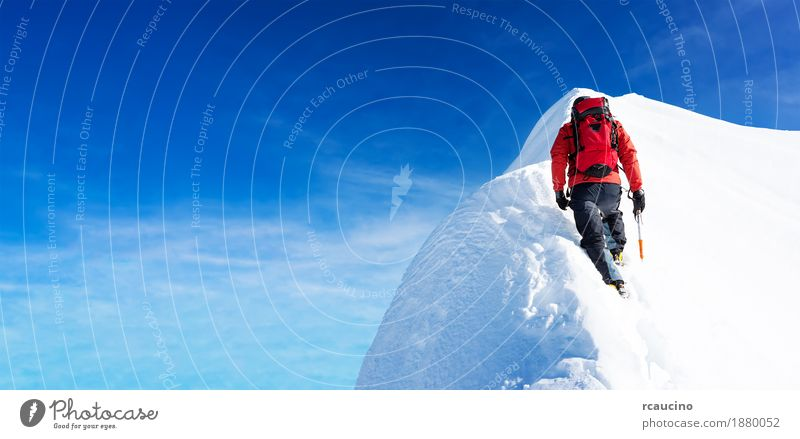 Mountaineer arrives to the summit of a snowy peak. Man Winter Sports Hiking Power Success Adventure Peak Climbing Expedition Performance Extreme Climber