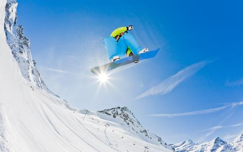 Snowboarder launching off a jump, Italy. Joy Vacation & Travel Winter Mountain Sports Boy (child) Man Adults Alps Jump Cool (slang) Dangerous cold Extreme fast