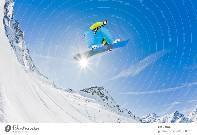 Snowboarder launching off a jump, Italy. Vacation & Travel Man Joy Winter Mountain Adults Sports Boy (child) Jump Dangerous Cool (slang) Alps Horizontal Guy
