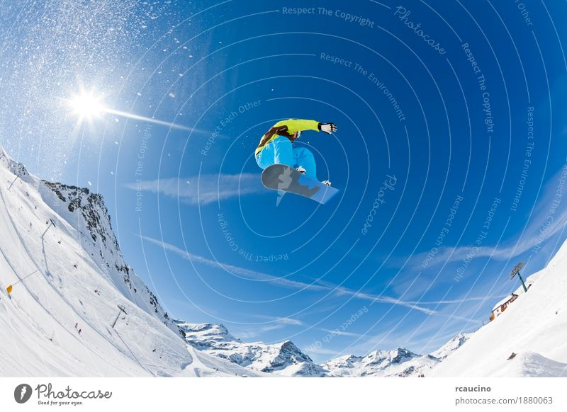 Snowboarder launching off a jump Vacation & Travel Man Sun Joy Winter Mountain Adults Sports Boy (child) Jump Dangerous Italy Cool (slang) Alps Horizontal