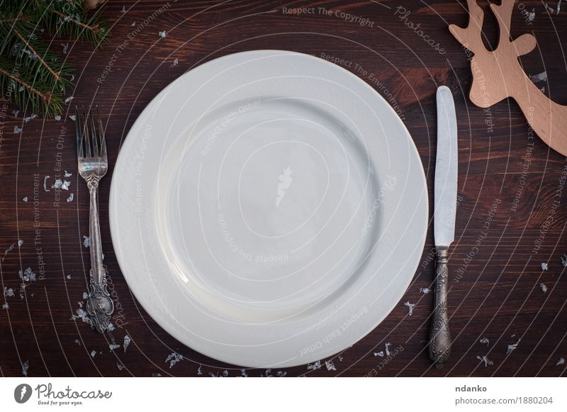 White plate with silver knife and fork on brown wooden surface Breakfast Dinner Banquet Crockery Plate Knives Fork Winter Snow Table Kitchen Restaurant Places
