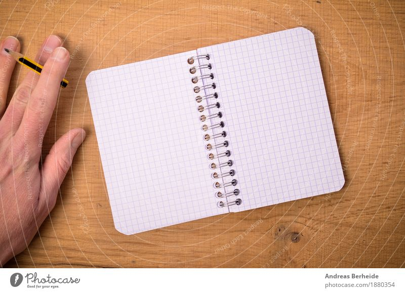 Hand with pencil and ring binder Office Business Notebook Musical notes Stationery Paper Piece of paper Pen Draw Write writing open left table