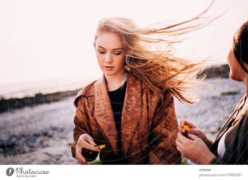 Portrait of young women with long blonde hair blowing in wind Woman Youth (Young adults) Summer Young woman Sun Joy Beach 18 - 30 years Adults Autumn Lifestyle Style Fashion Freedom Together Friendship