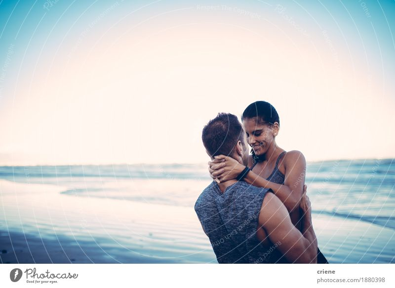 Cute fit couple hugging after fitness workout on beach Youth (Young adults) Young woman Young man Ocean Joy Beach Love Lifestyle Sports Couple Together Leisure and hobbies Waves Success Happiness Smiling