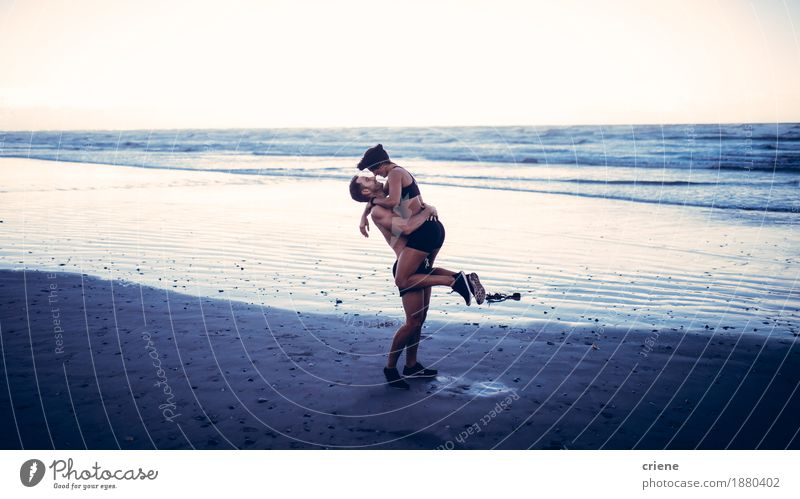 Young adult couple kissing on beach after running workout Youth (Young adults) Young woman Young man Joy Beach Love Lifestyle Sports Couple Together Leisure and hobbies Waves Body Smiling Fitness Cute
