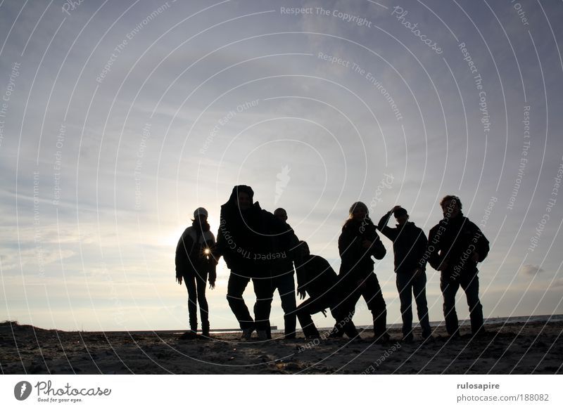 Human being Sky Nature Youth (Young adults) Blue Sun Ocean Winter Joy Beach Clouds Black Adults Freedom Movement Sand