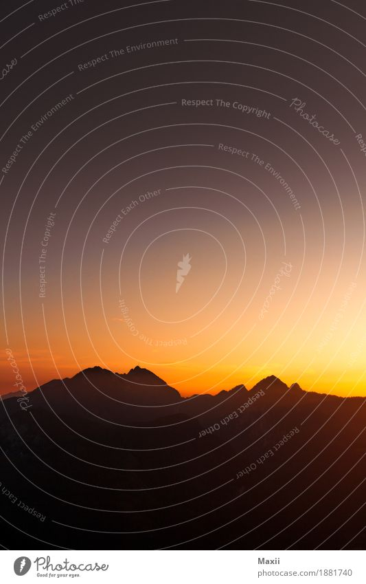 Mountain silhouette at sunset Environment Landscape Elements Sky Cloudless sky Sunrise Sunset Sunlight Spring Beautiful weather Alps Peak Relaxation Eternity
