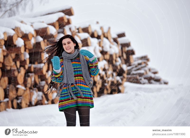 Beautiful young woman walking in winter outdoors Happy Winter Snow Young woman Youth (Young adults) Woman Adults 1 Human being 18 - 30 years Nature Clouds