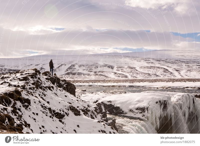 Hiker at mountain top of waterfall Godafoss Vacation & Travel Tourism Adventure Far-off places Sightseeing Winter Landscape waterfall: Godafoss Iceland frozen