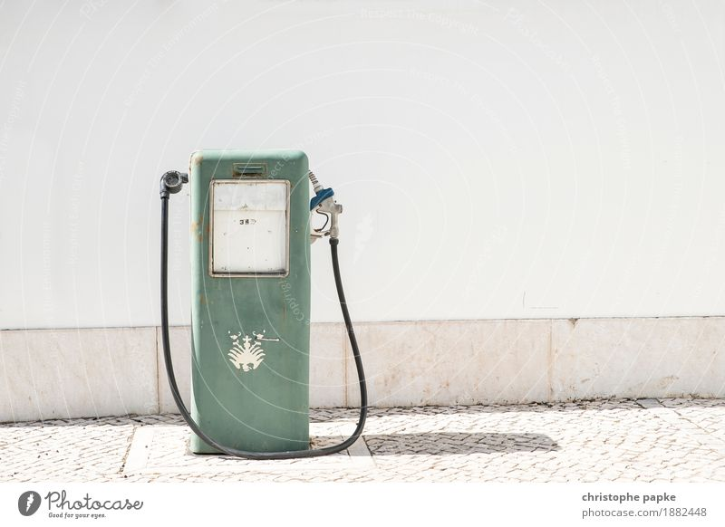 Old gas pump in front of white wall Petrol station Gasoline petrol price Petrol pump Refuel Summer refuel Wall (barrier) Wall (building) Transport Colour photo